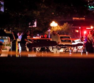 Several people in Ohio have been killed in the second mass shooting in the U.S. in less than 24 hours, and the suspected shooter is also deceased. (AP Photo/John Minchillo)