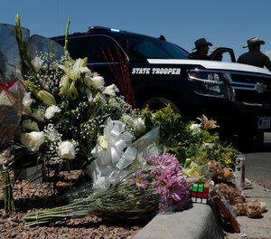 Flowers adorn a makeshift memorial near the scene of a mass shooting at a shopping complex in El Paso, Texas.