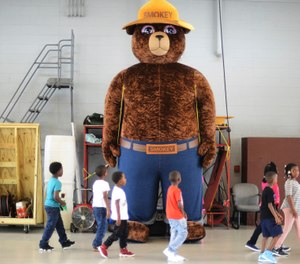 A giant Smokey Bear statue greets children at the Fire Department Open House at Fire Station One in Kinston, N.C. (Photo/Janet S. Carter, Daily Free Press via AP)