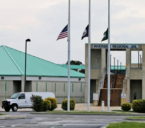This Aug. 7, 2018, photo shows the entrance to the Riverside Regional Jail in Prince George, Va. The jail was the site of a suicide by inmate Alex Wesley Tripp who died shortly after his arrival at the jail. (AP Photo/Steve Helber)