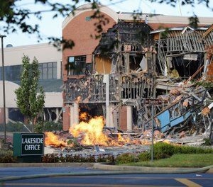 A natural gas explosion damaged a Maryland office complex and shopping center, ripping away part of the facade and exposing twisted metal. (Photo/Howard County Fire and Rescue via AP)