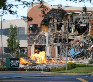 A natural gas explosion damaged a Maryland office complex and shopping center, ripping away part of the facade and exposing twisted metal.
