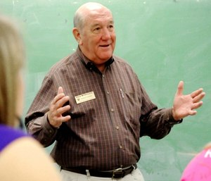 Volunteer teacher Dr. Skip McDannald makes a point to his class of students while teaching a lesson about the nervous system at Hawkinsville High School in Hawkinsville, Ga.
