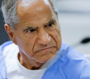 FILE - In this Wednesday, Feb. 10, 2016, file photo, Sirhan Sirhan reacts during a parole hearing at the Richard J. Donovan Correctional Facility in San Diego. Sirhan, Sen. Robert F. Kennedy's assassin, is hospitalized in stable condition after being stabbed by a fellow inmate at a Southern California prison, Friday, Aug. 30, 2019. (AP Photo/Gregory Bull, Pool, File)