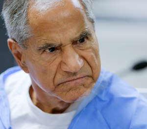 FILE - In this Wednesday, Feb. 10, 2016, file photo, Sirhan Sirhan reacts during a parole hearing at the Richard J. Donovan Correctional Facility in San Diego. Sirhan, Sen. Robert F. Kennedy's assassin, is hospitalized in stable condition after being stabbed by a fellow inmate at a Southern California prison, Friday, Aug. 30, 2019.