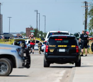 Odessa and Midland police and sheriff's deputies surround the area behind Cinergy in Odessa, Texas, Saturday, Aug. 31, 2019, after reports of shootings.