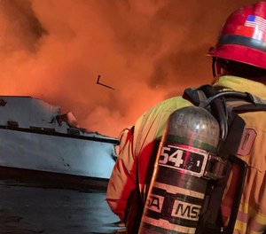 In this photo provided by the Ventura County Fire Department, VCFD firefighters respond to a boat fire off the coast of southern California.