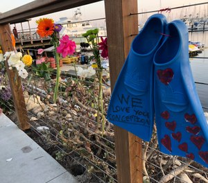 A memorial outside Truth Aquatics for the victims of the Conception boat fire. (Photo/AP, Stefanie Dazio)