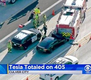 A Tesla Model S electric car crashed into a fire truck in Culver City, Calif. (Photo/KCBS-TV via AP)