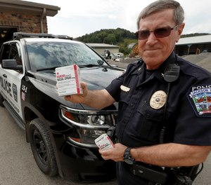 Jackson Township (PA) Police Chief Terry Seilhamer shows boxes of Narcan that department officers carry in the patrol vehicles, Thursday, Sept. 12, 2019.