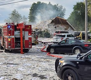 Emergency vehicles at the scene of a deadly propane explosion, which leveled new construction in Farmington, Maine. (Photo/Jacob Gage via AP)