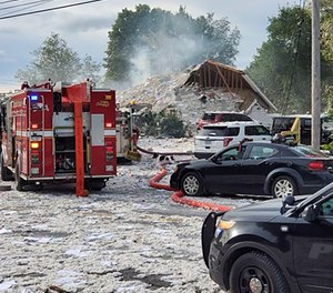 Emergency vehicles at the scene of a deadly propane explosion, which leveled new construction in Farmington, Maine.