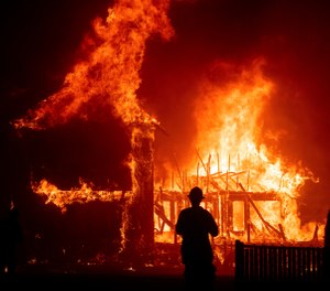 A home burns during a wildfire in Paradise, Calif. Gov. Gavin Newsom has signed nearly two-dozen laws aimed at preventing and fighting the devastating wildfires that destroyed the Sierra foothills city last fall. (Photo/AP. Noah Berger, File)