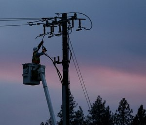 Pacific Gas & Electric lineman works to repair a power line in fire-ravaged Paradise, Calif. (AP Photo/Rich Pedroncelli)