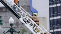 Unstable building, cranes hamper rescue attempt in New Orleans