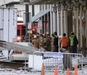 Construction workers are helped by emergency personnel after a large portion of a hotel under construction suddenly collapsed in New Orleans. (Scott Threlkeld/The Advocate via AP)