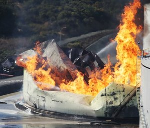 A tank burns as fire breaks out at a refinery in Crockett, Calif. (Anda Chu/San Jose Mercury News via AP)