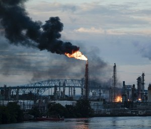 Federal investigators say an aging, failed elbow pipe appears to be the cause of the June fire and subsequent explosions that left five people with minor injuries and destroyed part of the processing unit at the largest oil refinery on the East Coast. (AP Photo/Matt Rourke)