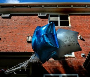 Balloons are seen at the scene of a Sunday fire in the Clinton-Peabody public housing complex in St. Louis. (Robert Cohen/St. Louis Post-Dispatch via AP)