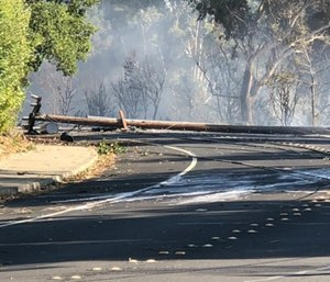 In this photo taken Sunday, Oct. 27, 2019, are power lines in Lafayette, Calif., that show damage near where a fire started. (Matthias Gafni/San Francisco Chronicle via AP)