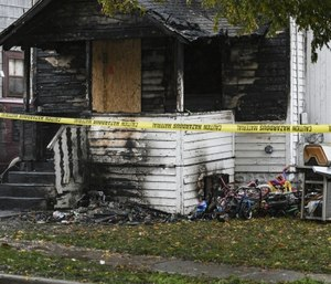 The aftermath of a fire at a home in the 2000 block of New York Avenue near Lake Lansing Road. (Matthew Dae Smith/Lansing State Journal via AP)