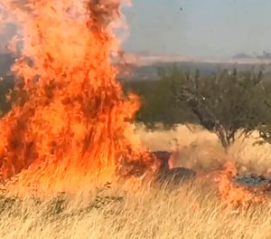 In this frame grab from a April 23, 2017, video provided by the U.S. Forest Service, is a gender reveal event in the Santa Rita Mountain's foothills, more than 40 miles southeast of Tucson, Ariz. The explosion from the reveal ignited the 47,000-acre Sawmill Fire. Gender reveal parties with a blast of color, pink or blue, that were once considered private gatherings have become social media spectacles, sometimes with dangerous consequences. (U.S. Forest Service via AP)