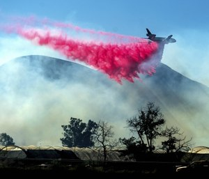 An air tanker drops retardant as the Maria Fire approaches Santa Paula, Calif. (AP Photo/Noah Berger)