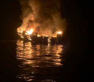 In this Sept. 2, 2019, file photo provided by the Santa Barbara County Fire Department, the dive boat Conception is engulfed in flames after a deadly fire broke out aboard the commercial scuba diving vessel off the Southern California Coast. The widow of Justin Dignam, one of the 34 people who died in the fire, has filed a lawsuit against the boat's owners, making it the first claim from one of the 34 victims' families. (Photo/Santa Barbara County Fire Department via AP, File)