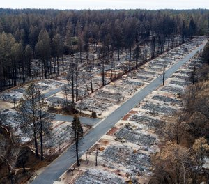 In this Dec. 3, 2018, file photo, homes leveled by the Camp Fire line a retirement community in Paradise, Calif. (AP Photo/Noah Berger, File)