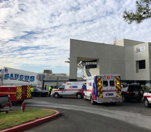 Ambulances are parked outside of Saugus High School after reports of a shooting on Thursday, Nov. 14, 2019 in Santa Clarita, Calif. (AP Photo/Marcio Jose Sanchez)