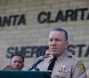 Los Angeles Sheriff Alex Villanueva expresses his condolences for the victims of the shooting at Saugus High School at a news conference at the station Santa Clarita, Calif., Friday, Nov. 15, 2019. (AP Photo/Damian Dovarganes)