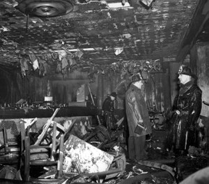 In this Nov. 28, 1942 file photo, firefighters inspect the ruins of the Cocoanut Grove nightclub in Boston, where 492 people died in a fire. A 2019 documentary film,
