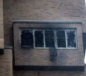 Broken windows and damage remain after a deadly fire at the high-rise apartment building on Nov. 27, 2019, in Minneapolis. (David Joles/Star Tribune via AP)