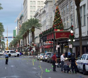 New Orleans police investigate the scene of a shooting Sunday, Dec. 1, 2019, on the edge of the city's famed French Quarter in New Orleans. (Photo/Max Becherer, The Advocate via AP)