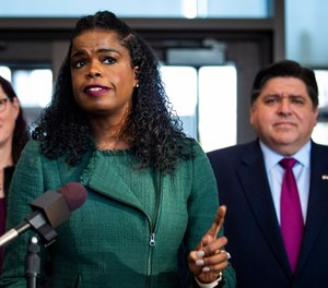 Illinois Gov. J.B. Pritzker looks on as Cook County State's Attorney Kim Foxx speaks during a press conference in Chicago after Foxx filed motions to vacate more than 1,000 low-level cannabis convictions, Wednesday, Dec. 11, 2019. (Ashlee Rezin Garcia/Chicago Sun-Times via AP)