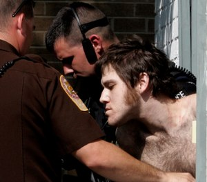 In this Aug. 21, 2006, file photo, William Morva is escorted out of the Montgomery County magistrates office after his capture in Christiansburg, Va. Morva was executed in 2017 for the murder of Cpl. Eric Sutphin. (AP Photo/Steve Helber, File)