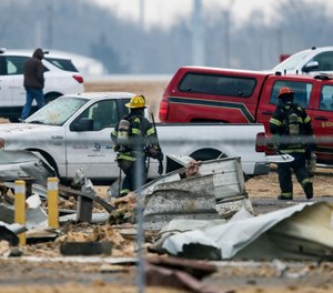 Authorities respond after a partial building collapse at Beechcraft aircraft manufacturing facility in Wichita, Kan., Friday, Dec. 27, 2019. More than a dozen people were injured Friday when a nitrogen line ruptured at the facility, causing part of the building to collapse, authorities said. (Photo/Travis Heying, The Wichita Eagle via AP)