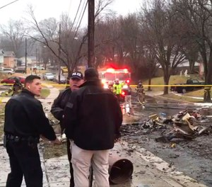 Firefighters and police officers investigate the scene of a small plane crash in the Lanham neighborhood, Md. (Photo/Prince George's County Fire/EMS)