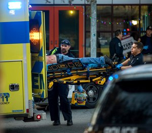 Paramedics transport a stabbing victim in Austin, Texas, on Friday, Jan. 3, 2020. (Jay Janner/Austin American-Statesman via AP)