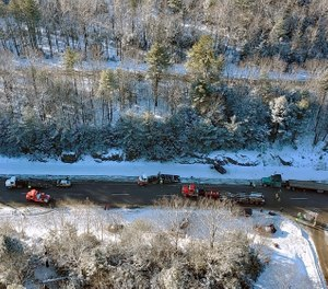 In this aerial photo from a Maine Forest Service helicopter released by the Maine State Police, emergency personnel work at the scene of a multi-car accident on Interstate 95 Tuesday, Jan. 7, 2020, in Carmel, Maine (Photo/Maine State Police via AP)
