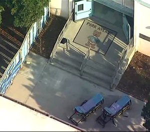 This aerial photo provided by KABC shows Park Avenue Elementary School in Cudahy, Calif., on Tuesday, Jan. 14, 2020. Fuel apparently dumped by an aircraft returning to Los Angeles International Airport fell onto an elementary school playground Tuesday, fire officials said. (Photo/KABC via AP)
