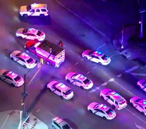 In this image made from video provided by NBC10 Philadelphia, police officers try to surround a stolen ambulance in an attempt to stop it in Philadelphia on Friday, Feb. 28, 2020. The ambulance fled from the police in the scene but was later captured. A man stole the ambulance and tried to run over an officer who shot him three times, leading to a low-speed chase through Philadelphia that lasted more than an hour Friday night, authorities said. (Photo/NBC10 Philadelphia via AP)