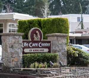 A sign at the entrance of the Life Care Center is show in Kirkland, Wash., near Seattle, Monday, March 2, 2020. Dozens of people associated with the facility are reportedly ill with respiratory symptoms or hospitalized and are being tested for the COVID-19 virus.