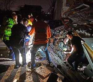 Rescue workers free two survivors from their home that collapsed, trapping them under rubble after a tornado hit area Tuesday, March 3 2020, in Mt. Juliet, Tenn. (Photo/Larry McCormack, The Tennessean via AP)