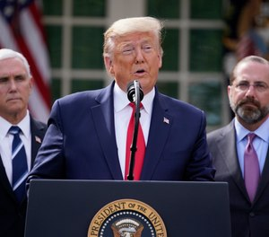 The announcement comes as House Speaker Nancy Pelosi and the Trump administration are laboring to finish the coronavirus aid package. (AP photo/Evan Vucci)