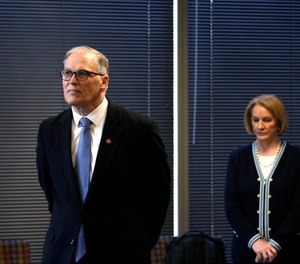 Wash. Gov Jay Inslee is seen with Seattle Mayor Jenny Durkan at a news conference. Durkan announced a similar vaccine mandate for city and county employees.