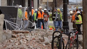 Construction workers looks at the rubble from a building after an earthquake Wednesday, March 18, 2020, in Salt Lake City. Image: AP Photo/Rick Bowmer