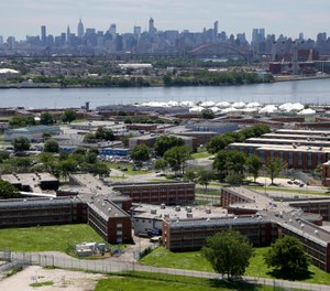 More than three dozens of people have tested positive for coronavirus in New York City jails, including at the Rikers Island jail complex, the board that oversees the city's jail system said Saturday, March 21, 2020. (AP Photo/Seth Wenig, File)