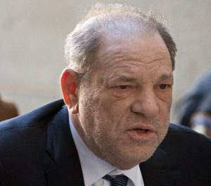 Weinstein tested positive for COVID-19 at a state prison in New York while serving a 23-year sentence for rape and sexual assault. (AP Photo/Mark Lennihan)