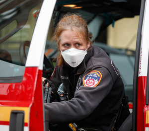 An FDNY provider wears personal protective equipment outside a COVID-19 testing site at Elmhurst Hospital Center in New York.